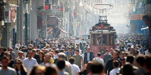 A Tram Makes it Way Along Istiklal Avenue in Istanbul