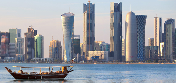 A Dhow (boat) Returning to Harbor in Doha, Qatar
