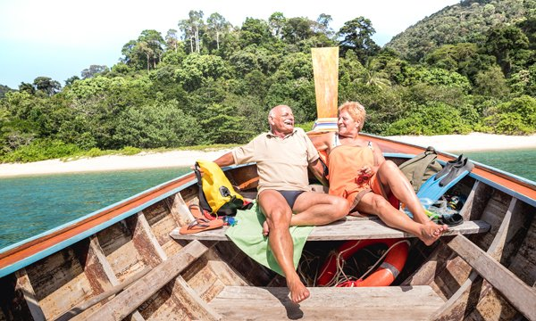Relaxing in the sun on a longtail boat in Thailand